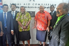 Prime Minister Voreqe Bainimarama is joined by Minister for Agriculture Inia Seruiratu and other guests after the unveiled of the Legal Aid Commission memorial plaque yesterday. Picture: LUKE RAWALAI