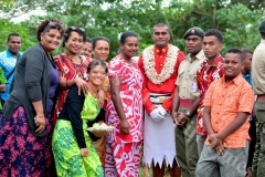 7s rugby star Apisai Domolailai (centre) was one the 203 new RFMF recruits who graduated at the Forces Training Group in Nasinu yesterday. He is photographed here with his family. Picture: JOVESA NAISUA