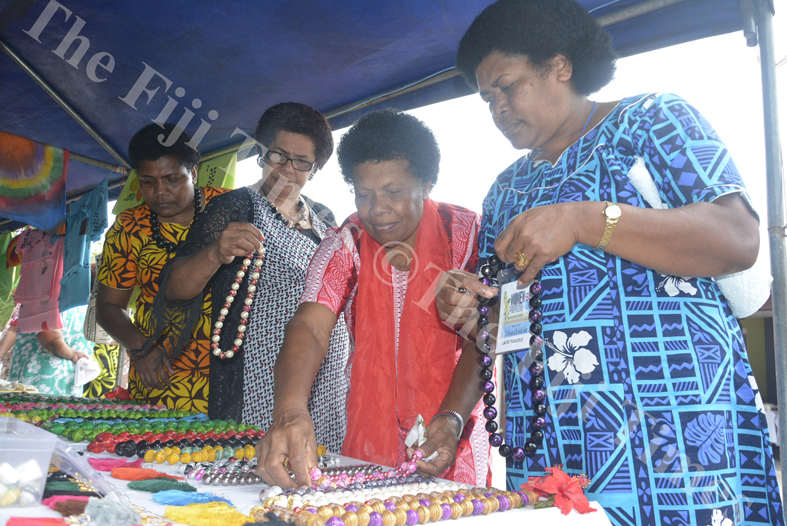 Laite Tuilolo (right) with Naomi Ratubuli, Lusiana Ucakereilagi and Sereana Sanoko look at some of the hand-made jewelleries at the Transformation International Fiji's 3rd Conference for Women on the Frontline in Lautoka. Picture: REINAL CHAND