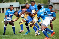 Northland's Semi Nasevunivai charges forward against Yasawa during the semifinal of the Vodafone Vanua Cup at Ratu Cakobau Park yesterday. Picture: JONA KONATACI