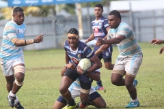 Lelean's Petero Koroduva on the attack against St John's College U18  during the Eastern Zone semifinal at Ratu Cakobau Park yesterday. Picture: JONA KONATACI