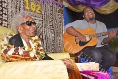 Ciri Vesi (left) entertained by Suliano Cecil of USP during her 102nd birthday celebration at the Golden Age Home in Samabula yesterday. Picture: RAMA