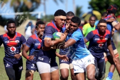 John Wesley Colleges u18 lock  Charles Kolitagane charges forward against Nasinu Secondary School u18 aduring the Southern Zone Semifinal at Suva Grammar School gorunds yesterday. Picture: JONA KONATACI