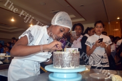 Cuvu College Student Shaimika Devi decorates a cake during the Chefs Challenge at the Outrigger Resort in Sigatoka. Picture: REINAL CHAND
