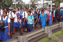 The ex-scholars and current students from Lelean Memorial School march through Nausori during the school's Diamond Jubilee cebration at the school ground in Nausori on Saturday. Picture: SUPPLIED.