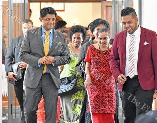 Attorney-General and acting Prime Minister Aiyaz Sayed-Khaiyum (left) with Angeline Chand of the Fiji Disabled Peoples Association outside Parliament yesterday. Picture: RAMA