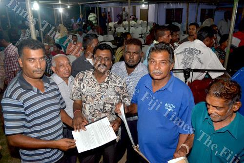 Minister for Local Government Parveen Kumar with the recipients of land leases in Ba. Picture: BALJEET SINGH/FT FILE