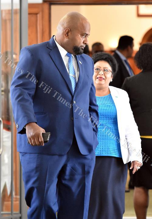 Government MP Howard Politini (left) and Assistant Minister for Women, Children and Poverty Alleviation Veena Bhatnagar outside Parliament yesterday. Picture: RAMA