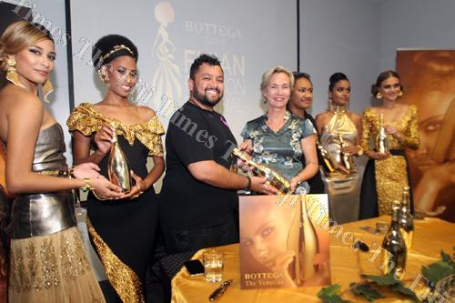 Fashion Council of Fiji chairperson Faraz Ali with Victoria Wines director Kate Vusoniwailala at the naming partnership announcement of the Bottega Gold Fijian Fashion Festival in Suva last week.Picture: JONA KONATACI