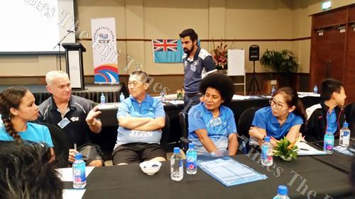 Sports psychologist Krishneel Maharaj (standing) assisting in a team discussion between Fiji Badminton and Fiji Table Tennis officials and players. Picture: PRAVIN NARAIN