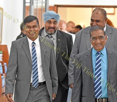 Happy quartet ... NFP Opposition members Biman Prasad (left) and Parmod Chand lead government MPs Balminder Singh and Joeli Cawaki during a break from Parliament sitting yesterday. Picture: RAMA