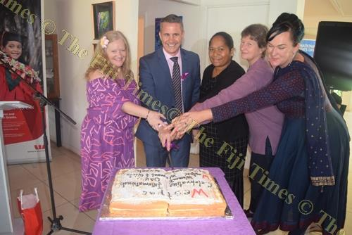 From left, Bernadette Welch, Westpac Fiji general manager Brett Hooker, Salaseini Daunabuna, Alison Burchell and Aleta Miller cut the cake to commemorate International Women's Day. Picture: SOPHIE RALULU