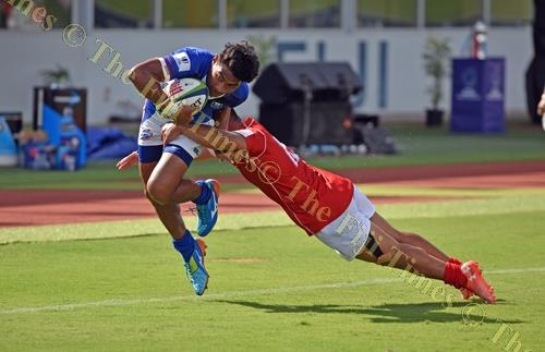 Mesala Seumalo of Samoa attacks against Tonga during their World Rugby Pacific Challenge at ANZ Stadium yesterday. Picture: RAMA
