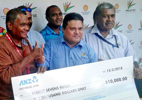 Marist Rugby Club president Lawrence Tikaram,Pacific Energy business executive Tapuaki Finauga and Anare Wailevu with officials of Marist Rugby 7s at the cheque presentation today. Picture: MAIKELI SERU