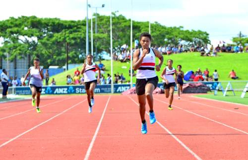 Adi Cakobau School's Serenia Ragatu leads the other runners to win the Intermediate Girls 200m event during the Triple N Zone competition at the ANZ Stadium in Suva today. Picture: JONACANI LALAKOBAU