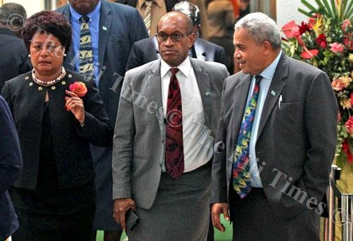 Opposition MP Salote Radrodro (left), Ministry of Employment, Productivity and Industrial Relations Minister Jone Usamate and Government MP Matai Akauola during a break in Parliament yesterday. Picture: JONA KONATACI
