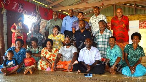 Fijian Elections Office supervisor Mohammed Saneem with villagers of Bua Lomanikoro yesterday. Picture: LUKE RAWALAI
