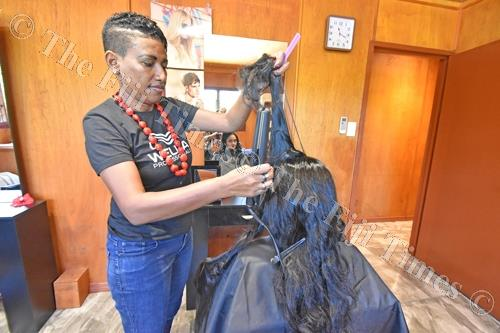 Mary Biggs works on a client's hair at the Moksha Spa in Baravi on the Coral Coast. Picture: RAMA