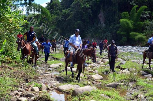 Prime Minister Voreqe Bainimarama on horseback during his tour of Noemalo District in the upper reaches of the Wainimala River two years ago. Picture: File