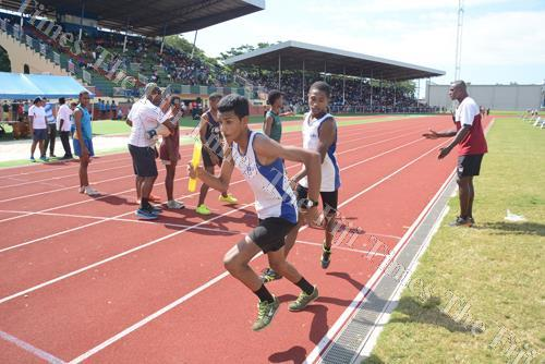 Xavier College's Avikesh Raju receives the baton during the junior boys 4x400m final during the Ba Zone at Churchill Park in Lautoka yesterday. Picture: REINAL CHAND