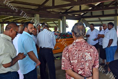 Families and friends of the late Pratap Singh pay their last respect at the Vatuwaqa cemetery in Suva. Picture: JONACANI LALAKOBAU