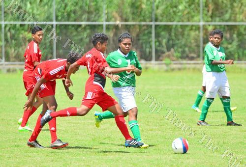 Rewa's Alisi Biu, third from left, battles for possession against Tailevu North during the Vodafone U18 Girls League at the Fiji FA Academy ground at Vatuwaqa, Suva, yesterday. Picture: JONACANI LALAKOBAU