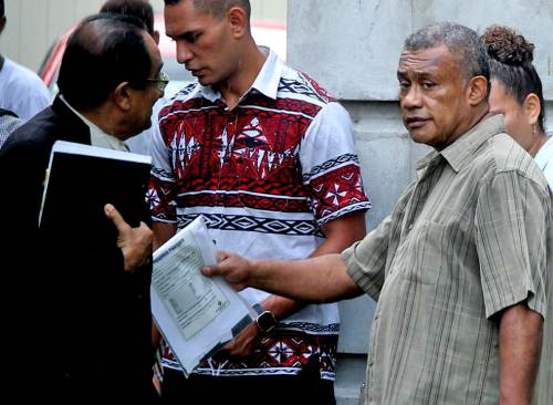 Lawyer Iqbal Khan and his client Samuela Waqa outside the Suva Magistrates Court this morning. Picture: JONA KONATACI