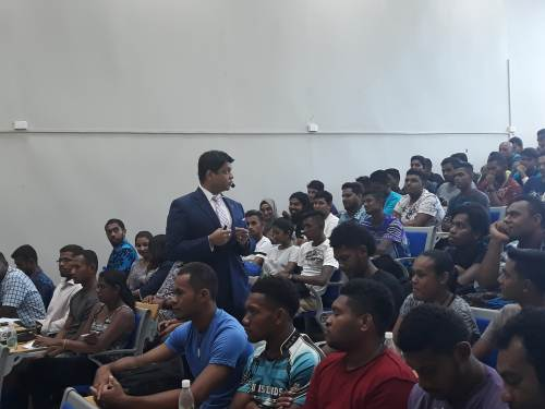 Students listen to AG Aiyaz Sayed-Khaiyum at FNU in Samabula this morning. Picture: ALISI VUCAGO