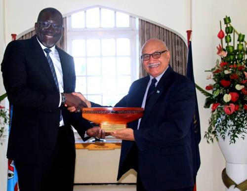 Fijian President Jioji Konrote presents a gift to Secretary General Elhadj As Sy after their meeting today at Borron house. Picture: SUPPLIED