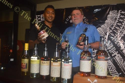 Alipate Laveti, left, and Liam Costello showcase different rum products during the Paradise Beverages Fiji Rum Expo in Nadi. Picture: SHAYAL DEVI