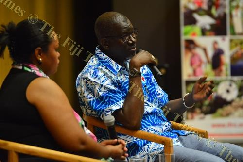 IFRC secretary general Elhadj As Sy (right) engages with members of the audience during discussions on voluntary humanitarian action in Pacific youth at the Japan-Pacific ICT Centre at USP in Suva on Monday. Picture: JOVESA NAISUA