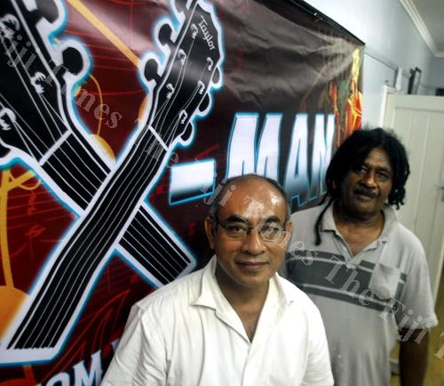Tabs Investment-sponsored Taylor X-man guitar challenge judge John Fong (left) and Seru Serevi at the FPRA office in Suva on Tuesday. Picture: ELIKI NUKUTABU