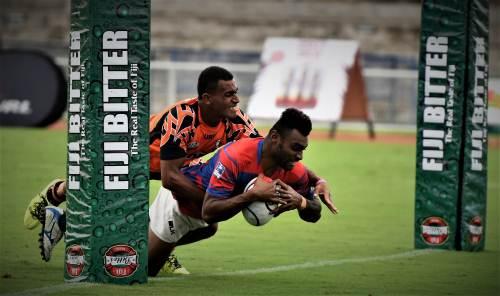 Nemani Raturuma of Marist scored a try against Muaniwavu Qauia during the Fiji Bitter Marist 7s at the ANZ Stadium. Photo: RAMA