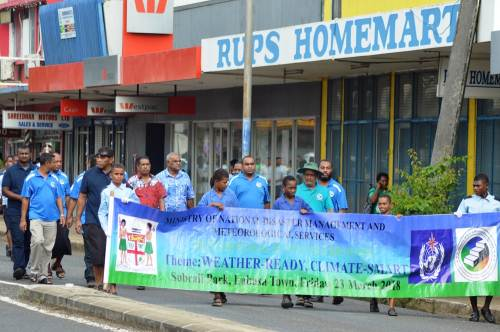 Members of the public who were part of the World Meteorological Day march through Labasa Town this morning. Picture LUKE RAWALAI