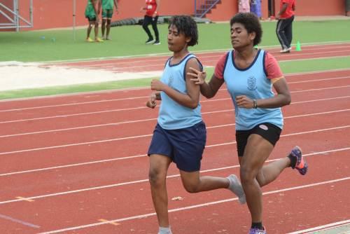 Ratu Navula College athlete Sainimere Tinaitabuliti (right) go past her team mate to win the Senior Girls 800m final. Picture: REINAL CHAND