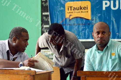 TLTB general manager Tevita Kuruvakadua, right, and the board's northern manager Josaia Waqairatu address an issue with a tenant. Picture: LUKE RAWALAI