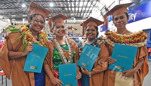 Bachelor of Arts graduates Vilimaina Naqelevuki (left), Chrishrita Aumanu, Anishma Jyoti Prasad and Ruci Vakamino after the graduation from University of the South Pacific at the FMF Gymnasium yesterday. Picture: RAMA