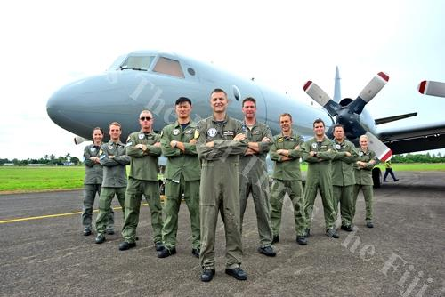 Flight Lieutenant Jonathan Pound, front, with his crew in front of the RNZAF P3 Orion aircraft at the Nausori International Airport after a demonstration flight yesterday. Picture: JONACANI LALAKOBAU