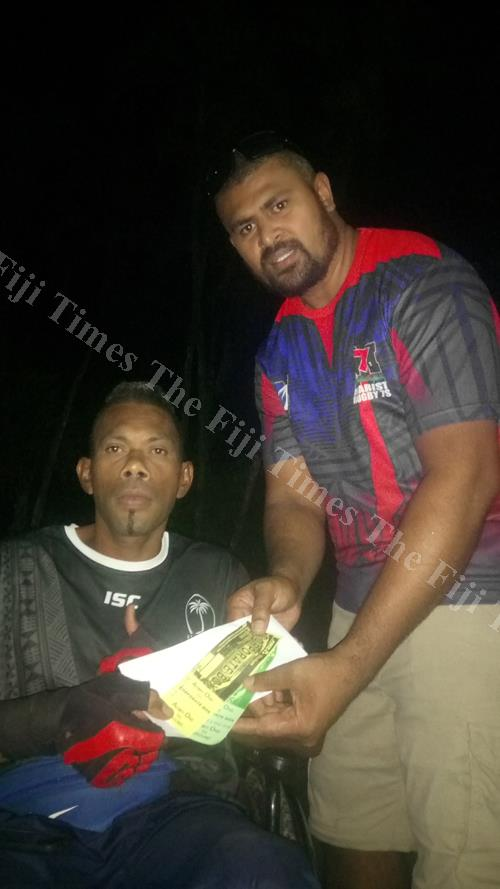 Sakeasi Lalai receives his tickets to the 42nd Fiji Bitter Marist 7s from MOB Media representative James Vunituraga. Picture: SUPPLIED/MOB Media