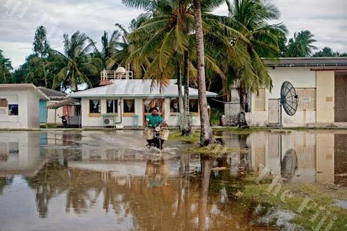 Flooding during king tides is a problem on Fongafale when water percolating up through the coral matrix laps even at the door of the meteorological office. Picture: SUPPLIED