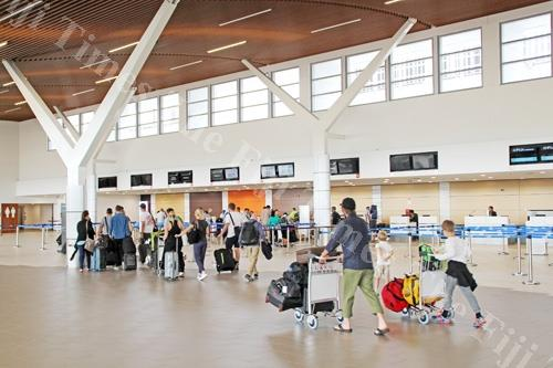 Passengers at the Nadi International Airport departure terminal. The airport was recently recognised among the World's Most Improved Airports. Picture: AFL