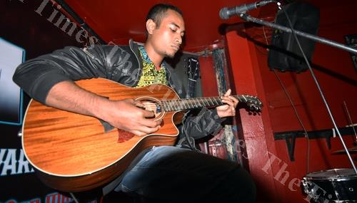 Togaliwaki Fuilakepa plays the guitar during the Taylor X-Man Tom Mawi Guitar Award competition at the Birdland Nightclub in Suva on Thursday night. Picture: RAMA