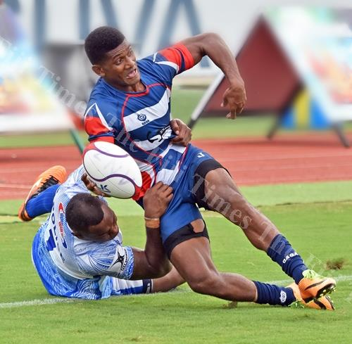 Inoke Tuisese of Police White brings down his Skaffworks team opponent during the 42nd Fiji Bitter Marist 7s at ANZ Stadium yesterday. Picture: RAMA