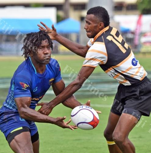 Nasoni Roko of Tabadamu Blues looks for support against Portsmouth Kelland Brothers during their match at the 42nd Fiji Bitter Marist 7s at ANZ Stadium yesterday.Picture: RAMA