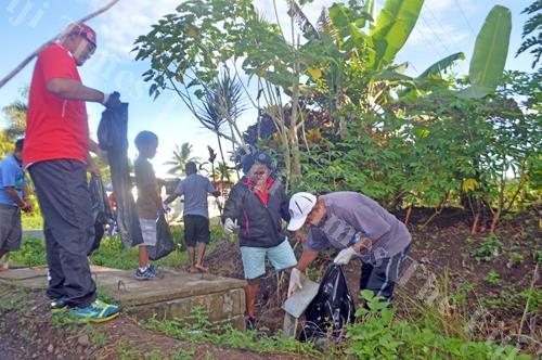 Left: Staff members of the Commissoner Northern's office pick up rubbish from a drain at Naqai settlement in Labasa yesterday. Picture LUISA QIOLEVU