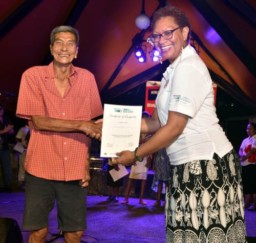 TB survivor Raymond Yam receives his certificate from Grant Management Unit's manager, Ministry of Health, Vasiti Nawadra Taylor, during the new TB logo launch and awareness at Sukuna Park last night. Picture: RAMA