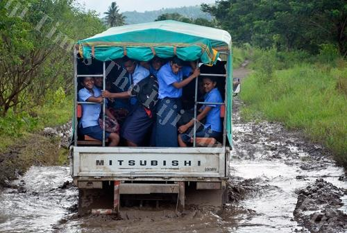 A RSL carrier loaded with school students makes its way up the Kavanagasau road in Sigatoka. Picture: BALJEET SINGH