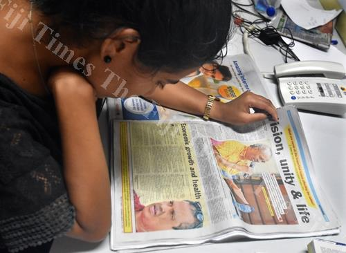 A reader reads the political platform in last Saturday's Fiji Times. Picture: RAMA