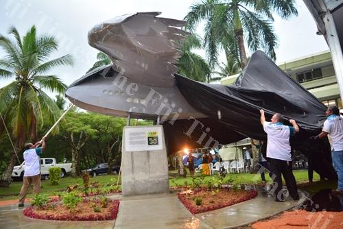 The staff of the University of the South Pacific unveiling the RNZAF Commemorative Monument at the University on Friday evening. Picture: JOVESA NAISUA