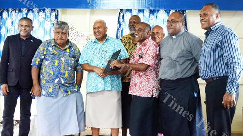 Prime Minister Voreqe Bainimarama (third from the left) hands over the lease documents to Sakiasi Seru of RKS Old Boys in Suva yesterday. Picture: ATU RASEA